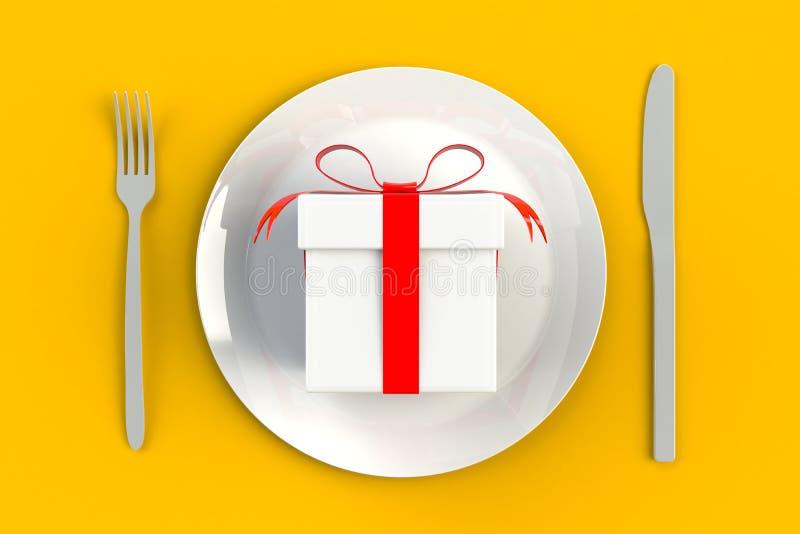 День рождества и Нового Года, подарочная коробка с красной лентой на плите, нож и вилка на желтой предпосылке таблицы стоковое фото rf
