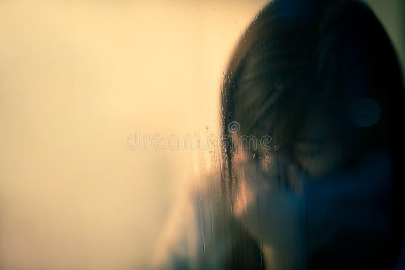 Депрессия чувства женщины стоковое фото