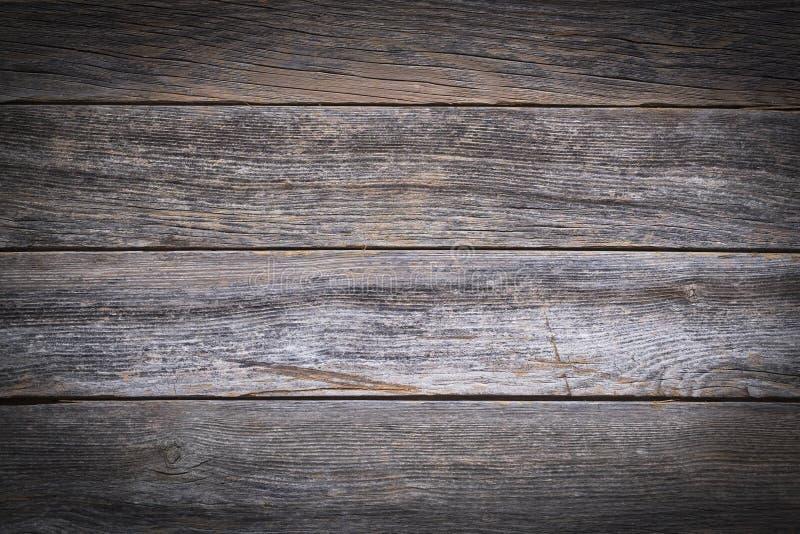 Деревенская деревянная предпосылка, выдержанные доски стоковое фото