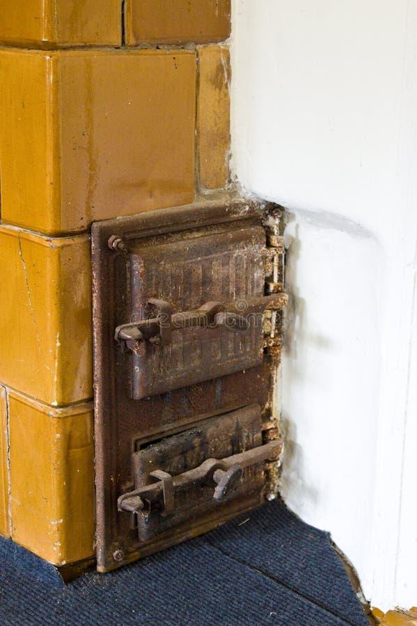 Деревенская домашняя старая деталь печи стоковые фото