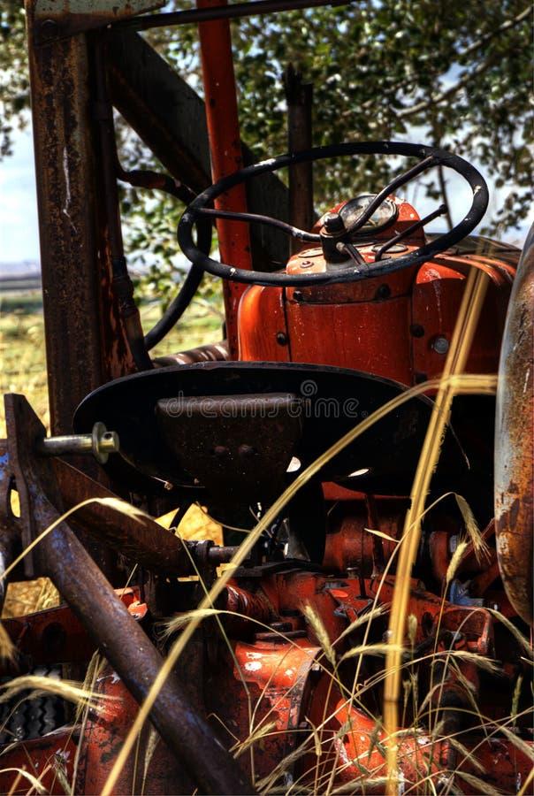 Деревенский старый трактор стоковое фото rf