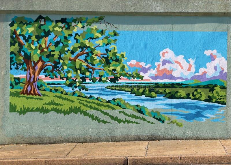 Дерево засаженное настенной росписью реки на дороге Джеймс в Мемфисе, Теннесси стоковые изображения