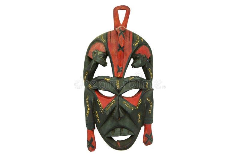 Деревянная африканская маска изолированная на белой предпосылке стоковая фотография