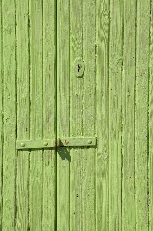 Деревянная зеленая дверь стоковое фото rf