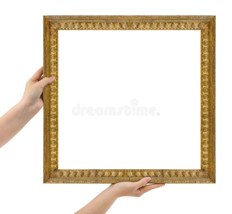 Деревянная картинная рамка в руках изолированных на белизне стоковое фото rf