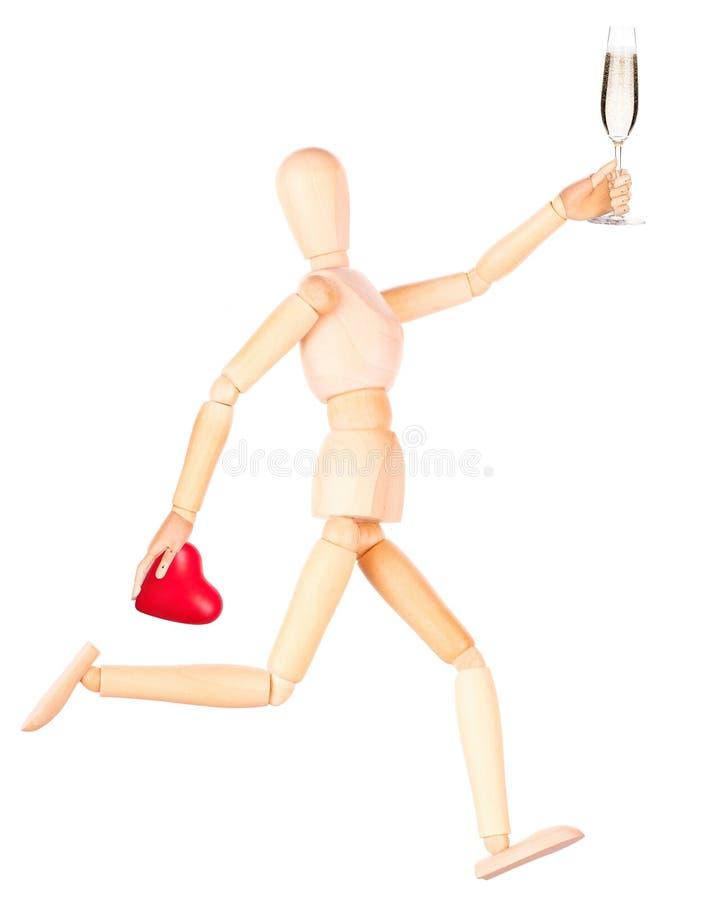 Download Деревянная кукла при шампанское держа красное сердце Стоковое Фото - изображение насчитывающей питье, шампанское: 40577228