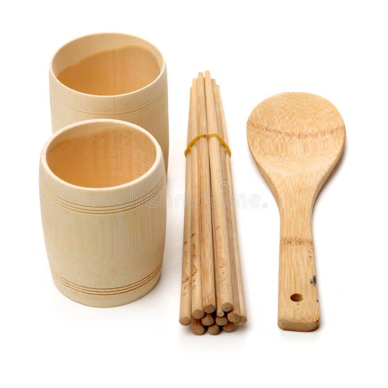Деревянная ложка, деревянная чашка и деревянные палочки стоковые фото