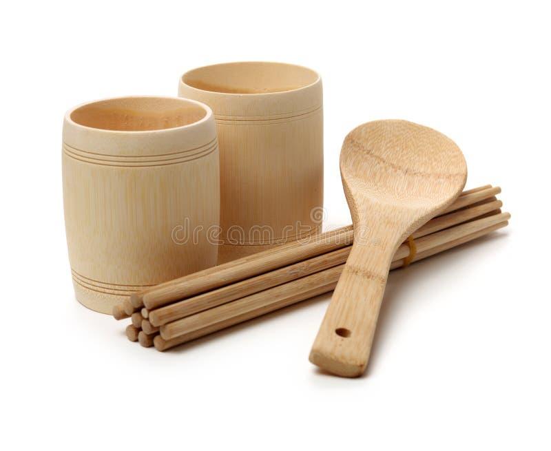 Деревянная ложка, деревянная чашка и деревянные палочки стоковое фото rf