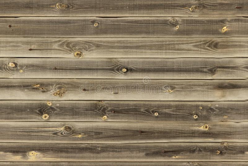 Деревянная подкладка всходит на борт стены текстура midtone коричневая деревянная панели предпосылки старые, безшовная картина Го стоковые изображения rf