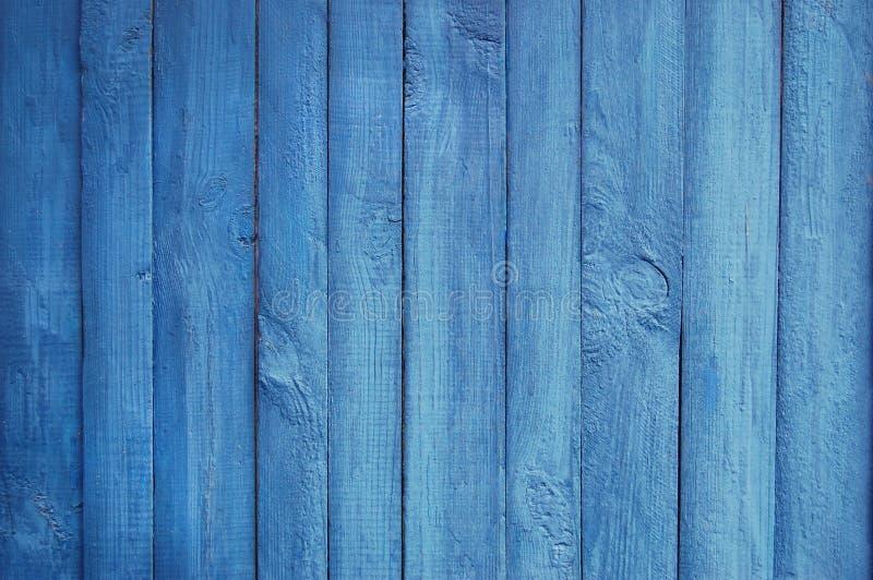 Деревянная предпосылка палисада, голубая краска стоковое фото
