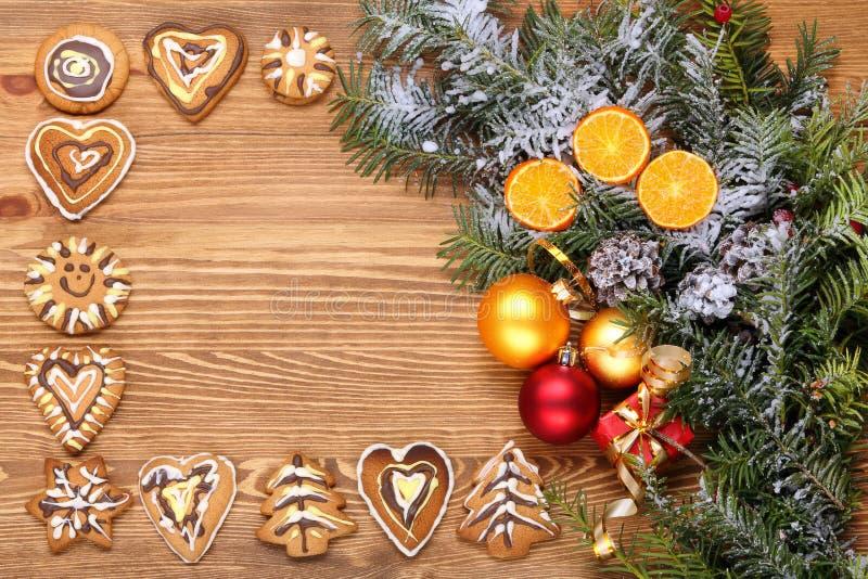 Деревянная предпосылка с украшениями рождества стоковые изображения