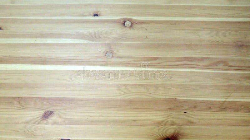 Деревянная предпосылка текстуры коричневого цвета планки стоковые изображения