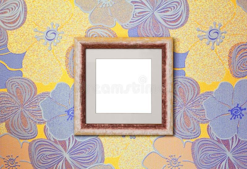 Деревянная рамка на стене стоковое фото