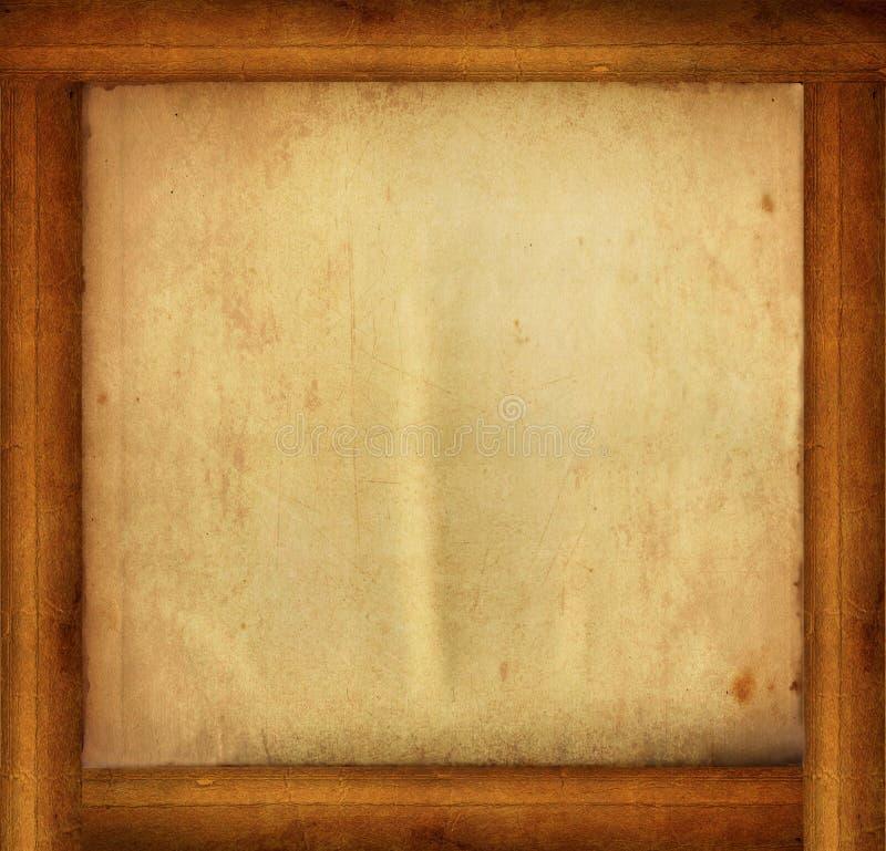Деревянная рамка с заполнением бумаги изолированным на белизне стоковое изображение