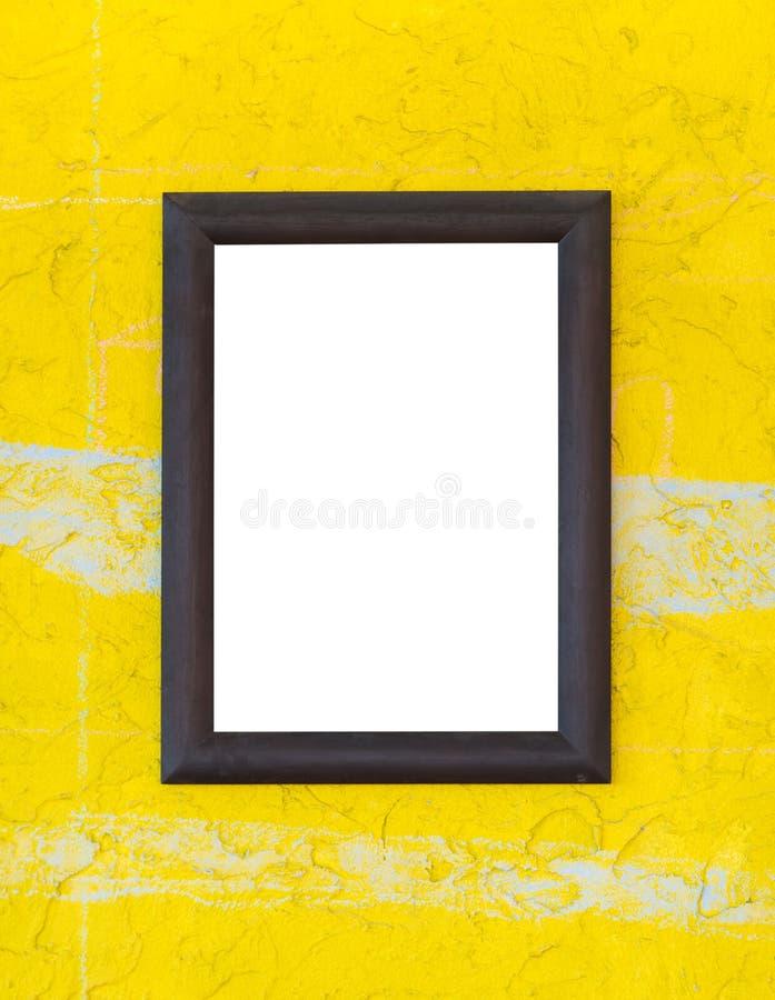 Деревянная рамка фото на желтой стене стоковое изображение rf