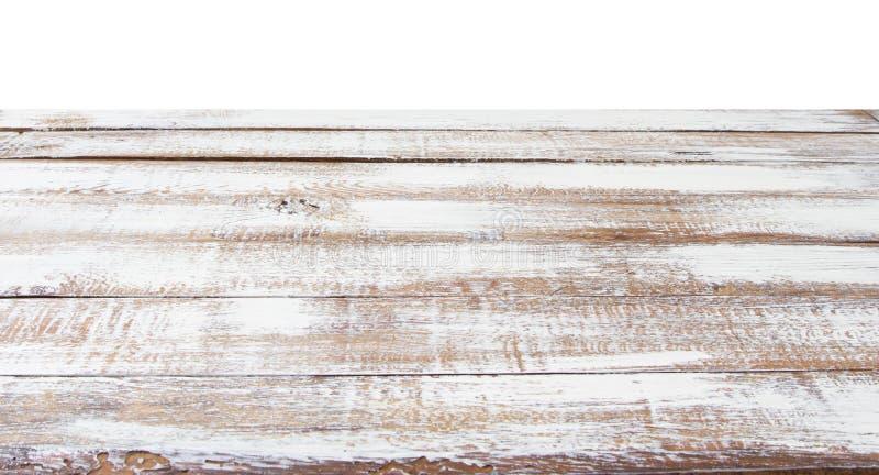 Деревянная столешница на белой предпосылке деревьев в парке - смогите быть использовано для дисплея или монтажа ваши продукты стоковые фото