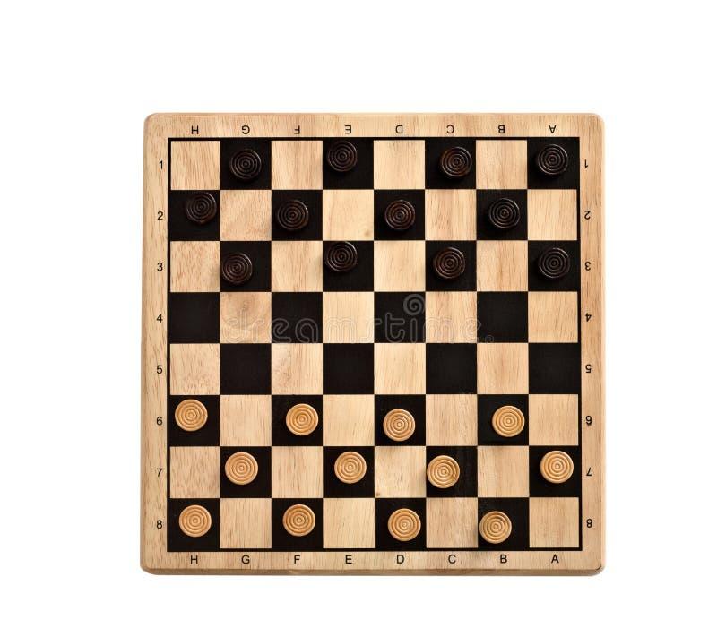 Деревянная шахматная доска с размеченными контролерами изолированными на белизне стоковая фотография rf