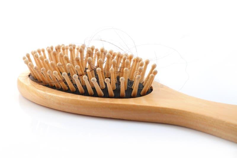 Деревянная щетка гребня с потерянными волосами стоковое фото