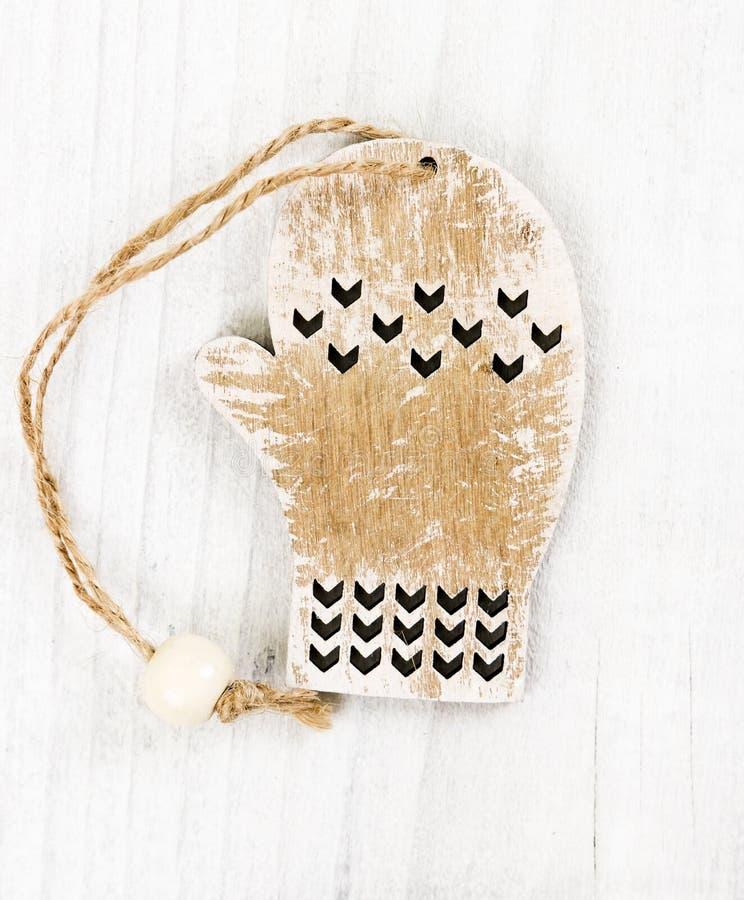 Деревянное украшение mitten рождества стоковая фотография