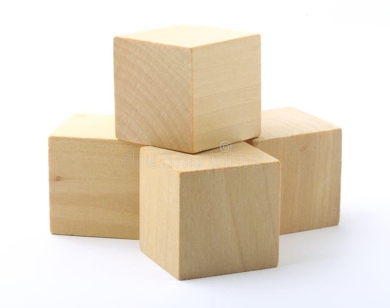 Деревянные блоки на белой предпосылке стоковое фото