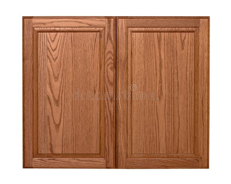 Деревянные изолированные двери шкафа стоковое фото