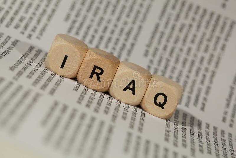 Деревянные кубы с письмами показано слово Ирак, абстрактная иллюстрация стоковые изображения rf