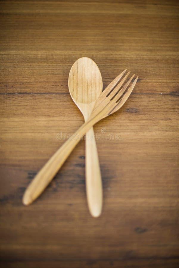 Деревянные ложки и деревянная вилка стоковое изображение rf