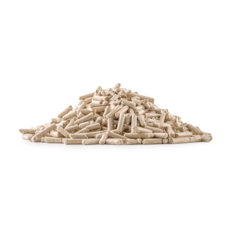 Деревянные отжатые лепешки от биомассы на белизне изолировали backgrou стоковые фото
