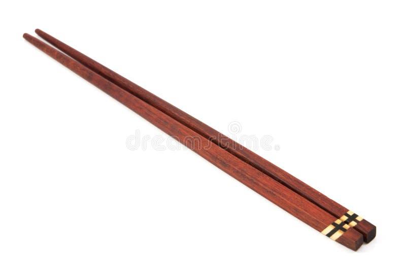 Деревянные палочки на белизне стоковое изображение