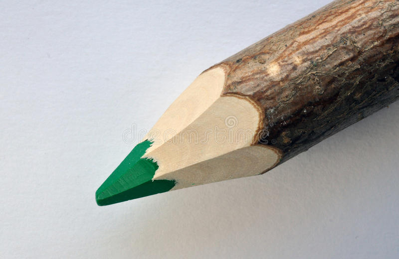 Деревянный зеленый crayon стоковое фото rf