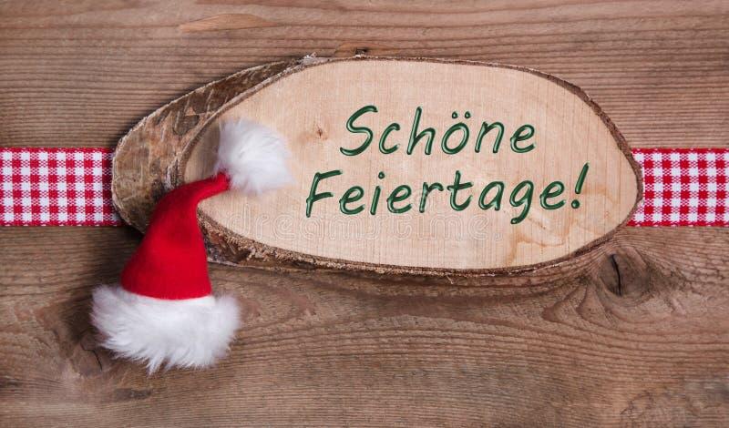 Деревянный знак с с Рождеством Христовым сообщением и checkered лентой стоковая фотография rf