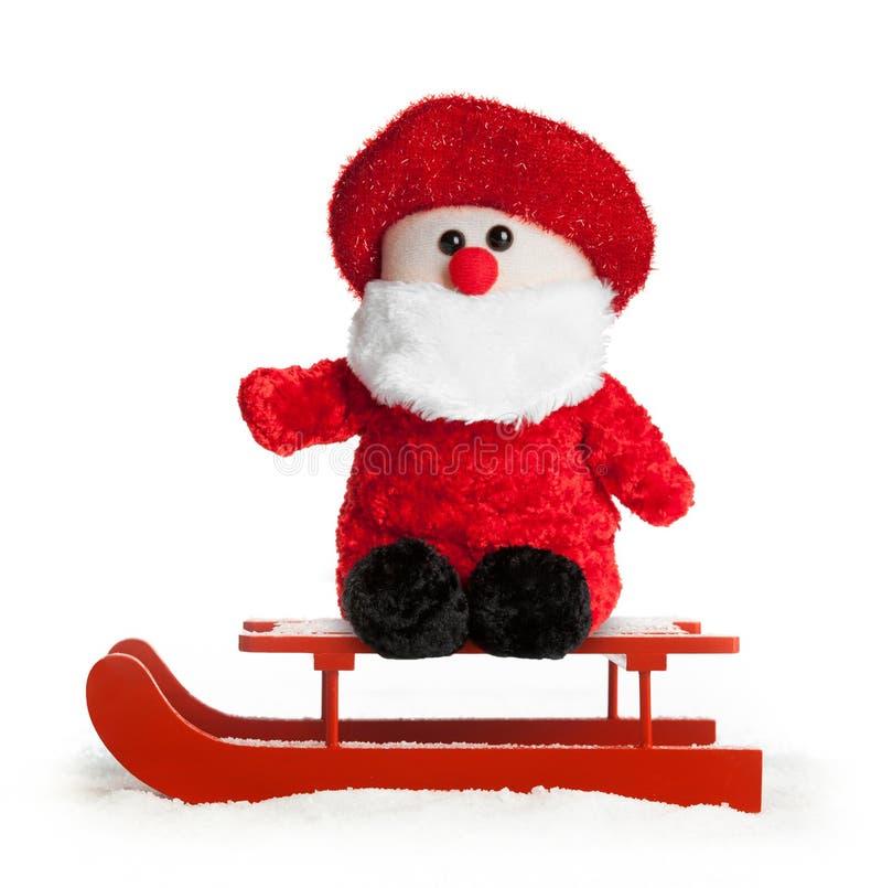 Деревянный красный скелетон с плюшем Санта Клауса стоковая фотография