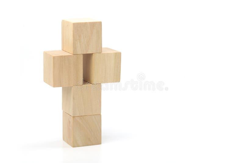 Деревянный крест на белой предпосылке стоковое изображение rf