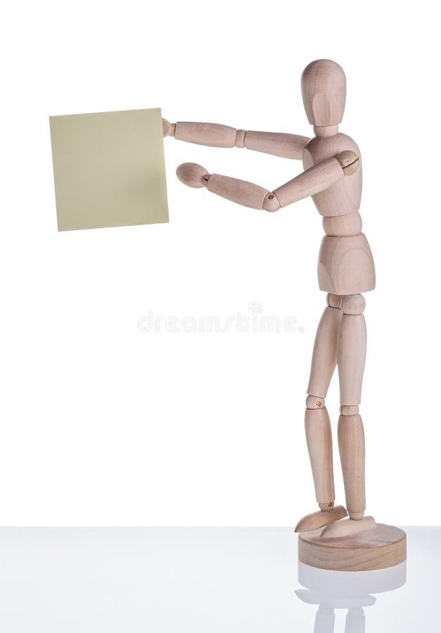 Деревянный манекен показывает стикер стоковая фотография