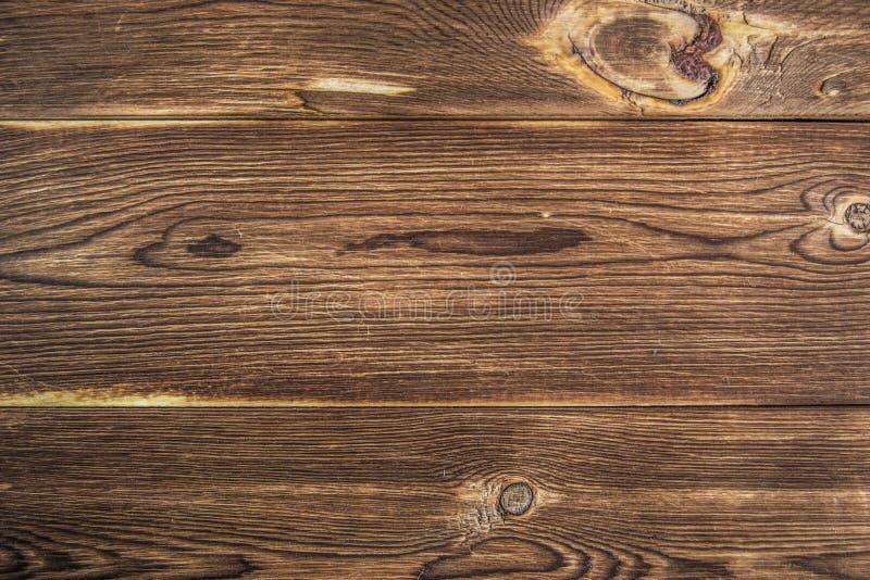 Деревянный стол постучанного вниз коричневого цвета доск стоковая фотография rf