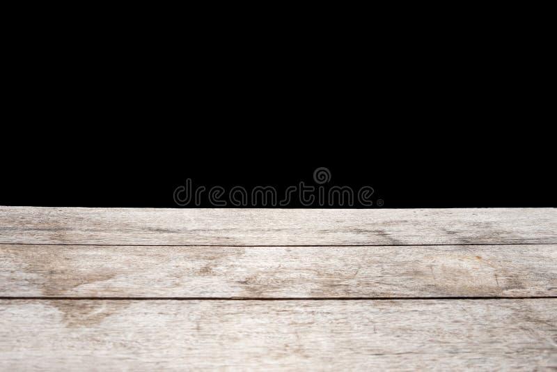 Деревянный стол с черной темной предпосылкой интерьер перспективы стоковое изображение rf
