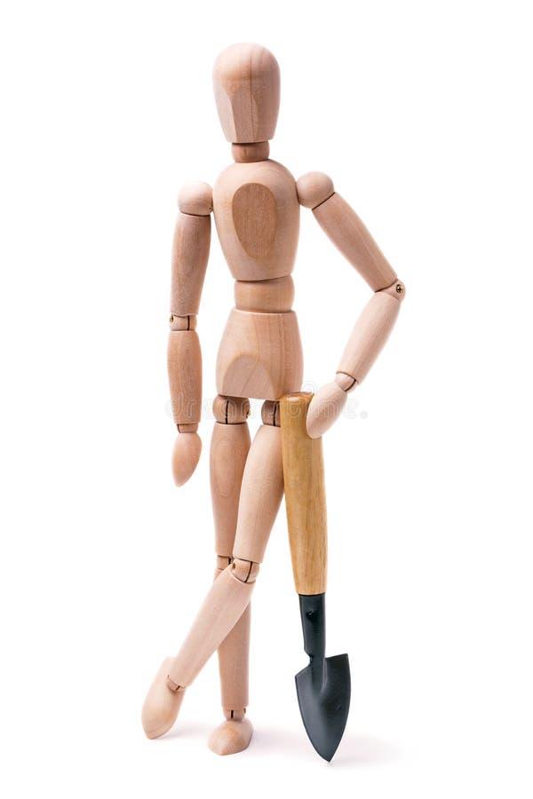 Деревянный человек с лопаткоулавливателем стоковое изображение