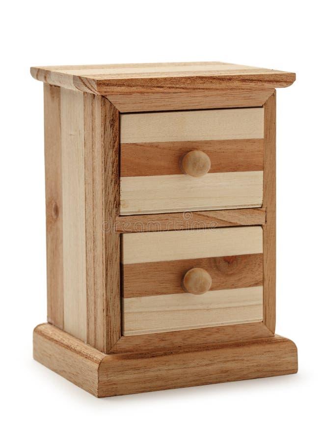 Деревянный ящик комода на белой предпосылке стоковая фотография