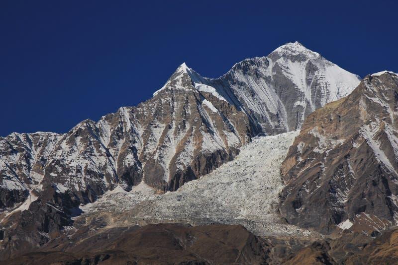 Держатель Dhaulagiri и падение льда стоковые фотографии rf