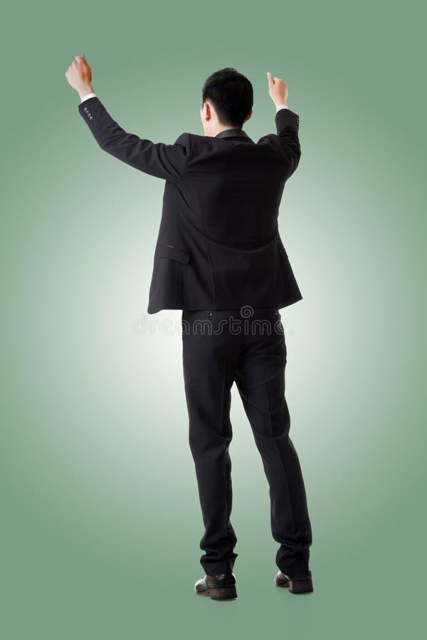 Держать представление азиатского бизнесмена стоковое изображение