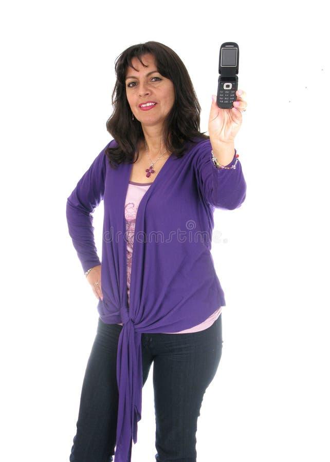 держащ чернь вне позвоните по телефону женщине стоковое фото rf