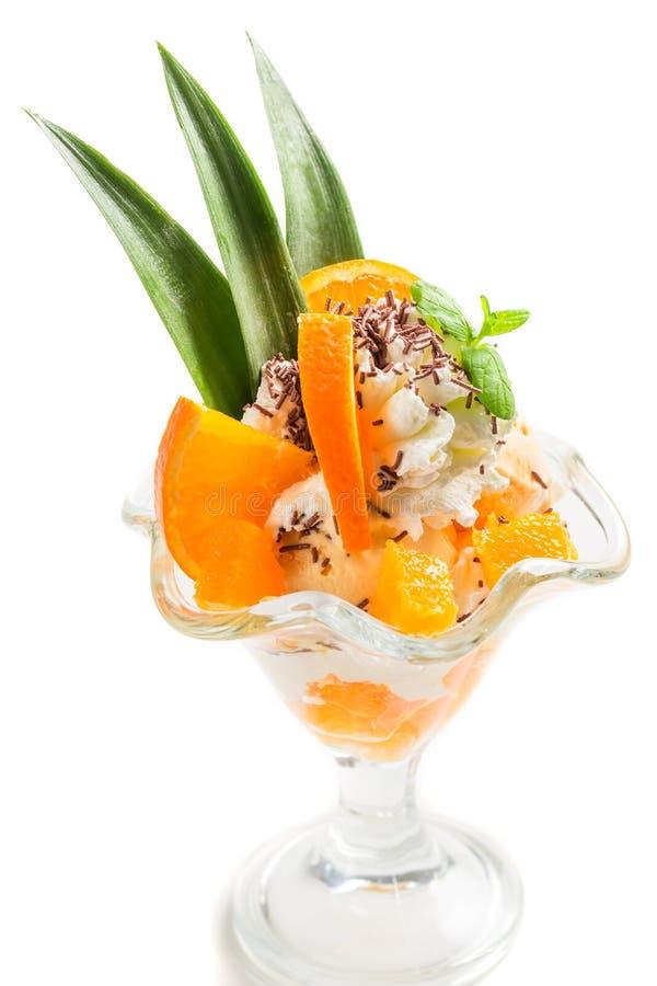 Десерты с апельсином и мороженым стоковая фотография