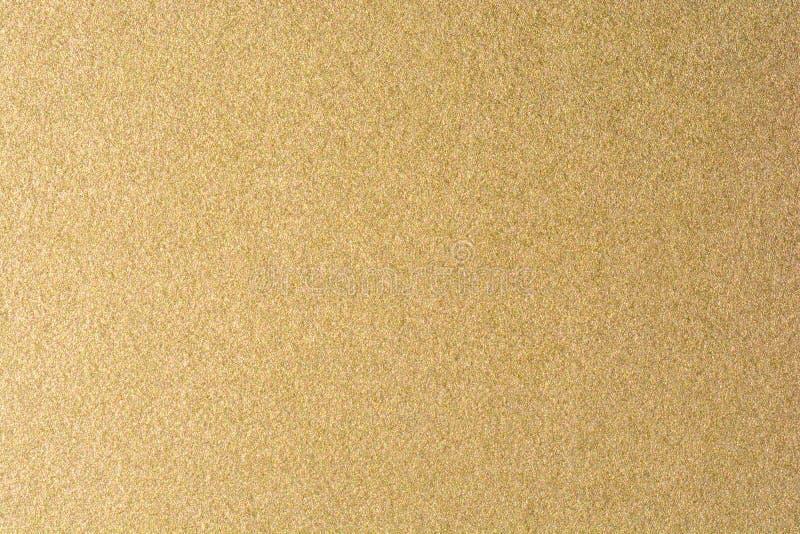 Детали золотой предпосылки текстуры Стена краски цвета золота Роскошные золотые предпосылка и обои Сусальное золото или стоковые фото