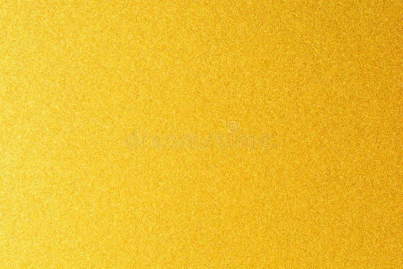 Детали золотой предпосылки текстуры Стена краски цвета золота Роскошные золотые предпосылка и обои Сусальное золото или стоковые изображения rf