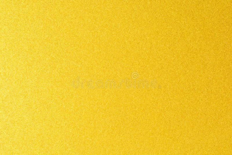 Детали золотой предпосылки текстуры Стена краски цвета золота Роскошные золотые предпосылка и обои Сусальное золото или стоковая фотография