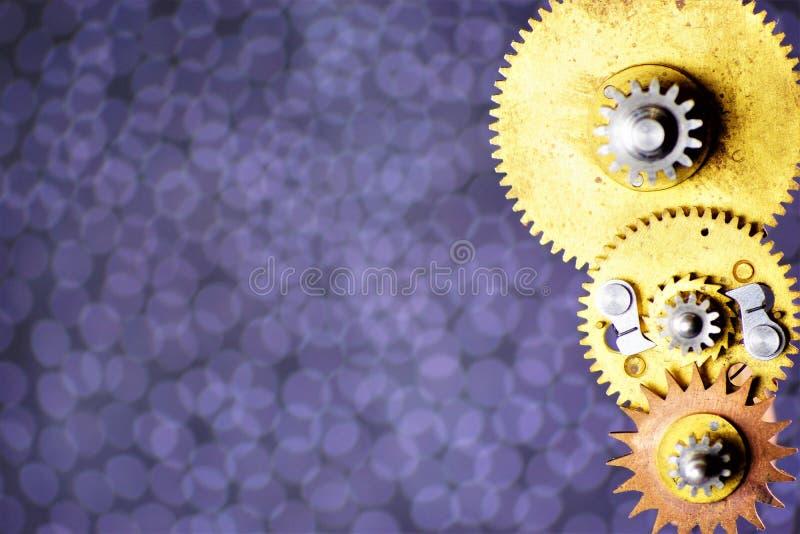 Детали механизма винтажные вокруг toothed шестерней, на предпосылке для дизайна Шестерни передают вращательное движение между вал иллюстрация штока