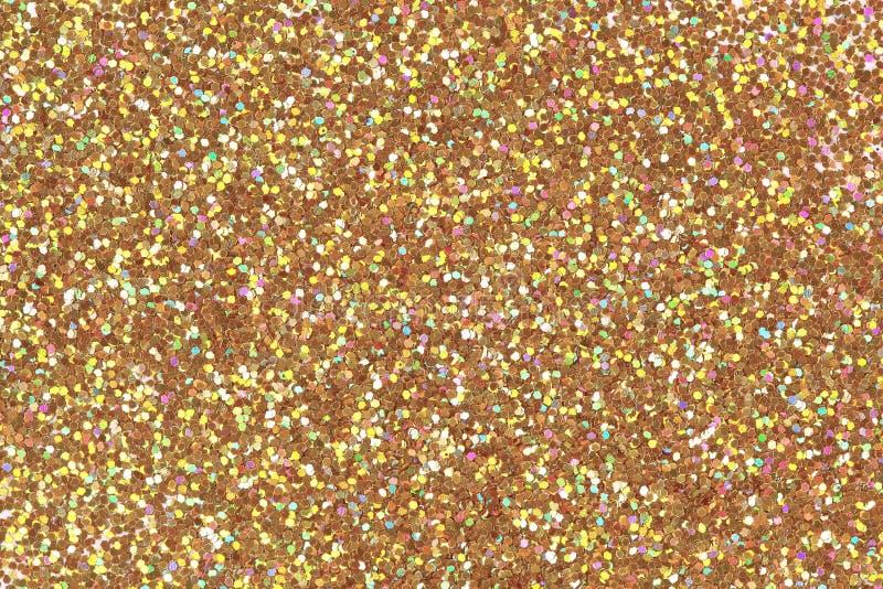 Детальная текстура блестящей золотой поверхности пыли Яркая исключительная предпосылка, картина Низкое фото контраста стоковое изображение