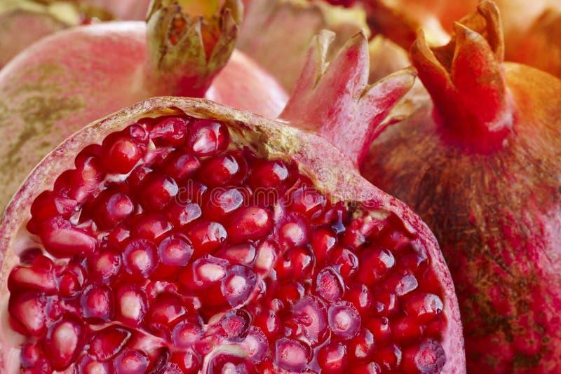 Деталь макроса семян плода гранатового дерева еда здоровая Красный цвет стоковое изображение