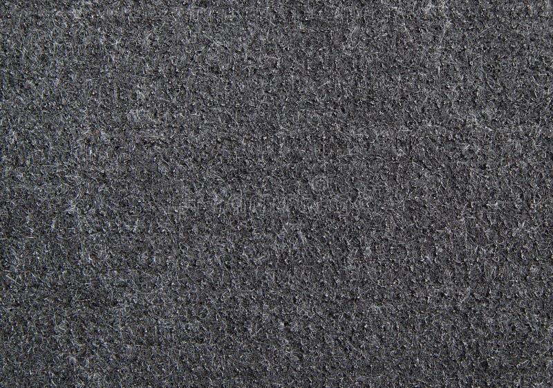 Деталь черной резиновой текстуры коврика у входной двери стоковая фотография rf