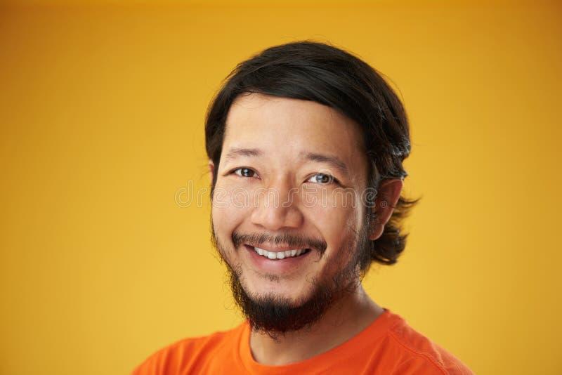 детеныши азиатского счастливого человека сь стоковая фотография rf